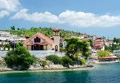 stock photo of neo  - Greece Sithonia view of the church on the waterfront in Neos Marmaras - JPG