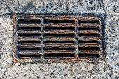foto of piercings  - Corroded Rusty Storm Drain in concrete pierce in the sea - JPG