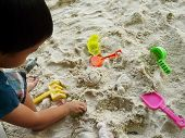 foto of playground  - Child playing with sand on the playground - JPG
