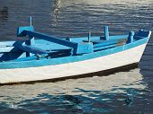 picture of sloop  - old blue  wooden boat on the sea - JPG