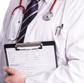 pic of hospital patient  - Male doctor fills patient registration form prior to admission and examination - JPG
