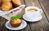 pic of bakeshop  - Homemade muffins and a cup of tea with lemon on wooden background - JPG