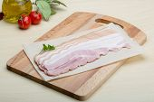 picture of bacon strips  - Raw Bacon strips on the wood background - JPG
