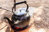 image of boiling water  - old kettle for boiling water on charcoal stove - JPG
