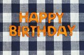 pic of pretzels  - Happy birthday written with pretzel letters on checkered cloth - JPG