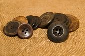 stock photo of hasp  - A lot of old buttons scattered on the old cloth - JPG