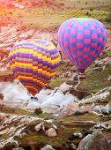 foto of chimney rock  - Colorful hot air balloons flying over rock landscape at Cappadocia - JPG