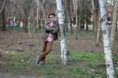 pic of early-man  - young man walks in the early spring in a lush park - JPG