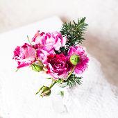 picture of doilies  - Little cozy bouquet in glass bottle over crochet doily - JPG