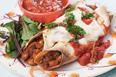pic of enchiladas  - Mexican enchilada dish with tortillas in chili sauce - JPG