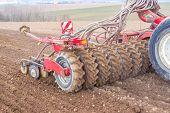 stock photo of plow  - Sowing and plowing action in the spring season - JPG