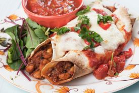 picture of enchiladas  - Mexican enchilada dish with tortillas in chili sauce - JPG