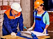 image of millwright  - Happy group people old man and young woman builder cutting ceramic tile - JPG