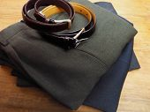 Mens trousers and belt on table ready for use. poster