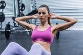 picture of crunch  - Muscular woman doing abdominal crunch at the crossfit gym - JPG