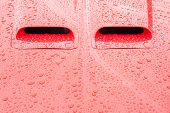 picture of raindrops  - red vehicle hood and engine intakes covered in raindrops - JPG