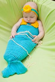image of undine  - Baby girl dressed as a mermaid on green - JPG