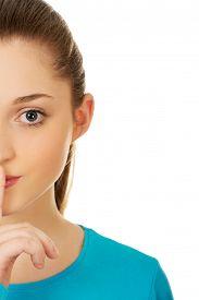 foto of hush  - Beautiful teen woman with hush gesture - JPG
