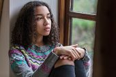 Beautiful mixed race African American girl teenager female young woman sad depressed or thoughtful l poster