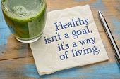 Healthy is not a goal, it is a way of living advice or reminder - handwriting on a napkin with a gla poster
