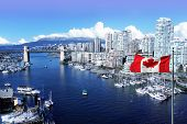 Canadian flag in front of view of False Creek and the Burrard street bridge in Vancouver, Canada.  poster