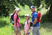stock photo of happy family  - Family hiking in the countryside - JPG