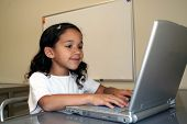 stock photo of school child  - Child at School on the computer smiling - JPG