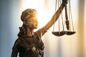 Statue Of Justice With Scales In Lawyer Office. Legal Law, Advice And Justice Concept poster