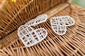 Wicker Basket Pattern With Three White Wicker Hearts. Close Up. Background. poster