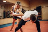 Woman makes elbow kick, self-defense workout poster