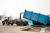 A Special Heavy Machine Loads A Container With Sorted Waste At The Plant For Sorting Waste To Be Tra poster
