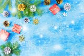 Blue Christmas Background With Fir Branches, Red Giftboxes, Golden Decorations And Snow Falling, Cop poster