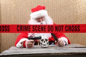 Santa Claus. Santa Crime Scene. Santa Claus holds a Gun and Knife to a Human Skull for an unexpected poster