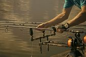 Angling, Hobby, Sport, Activity, Recreation. Rods, Reels, Lines And Male Hands On Water Background F poster