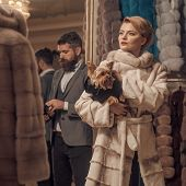 Woman In Fur Coat With Man, Shopping, Seller And Customer. Date, Couple, Love, Man And Woman. Couple poster