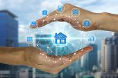 Hand Holding And Protection With Property Investment Icons Over The Network Connection On Property B poster