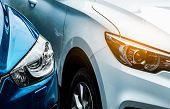 Close Up Headlamp Light Of Blue And White Suv Car. Blue Car Parked Beside White Car. Automotive Indu poster