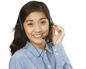 image of filipina  - A young smiling woman wearing a headset  - JPG