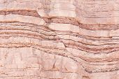 pic of sedimentation  - Detail of geological formations in faulted sandstone sedimentary rock - JPG