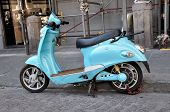 picture of vespa  - Classic Italian Vespa scooter parked in the street - JPG