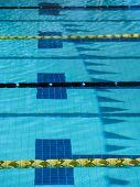 foto of swim meet  - Swim meet pool with lane ropes and ribbon  - JPG