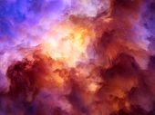 stock photo of storms  - Surreal storm clouds shading from dark purples and reds to oranges and yellows symbolizing a range of concepts such as creation the birth of stars or an ominous maelstrom - JPG
