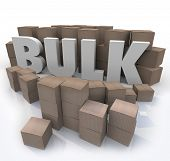 The word Bulk surrounded by cardboard boxes and packages at a wholesale store to illustrate savings