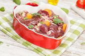 picture of giblets  - Raw chicken liver in heart shaped bowl - JPG