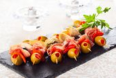 picture of artichoke hearts  - Antipasti skewers with olives - JPG