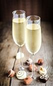 Two Glasses Of Champagne With Candies