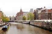 AMSTERDAM, NETHERLANDS - 18 MAY: Canals of Amsterdam on 18 May 2009 in Amsterdam, Netherlands. Amste