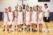 picture of 13 year old  - Portrait Of High School Sports Team In Gym With Coach - JPG