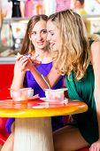 stock photo of ice cream parlor  - Friends meeting in ice cream parlor or cafe with cappuccino and ice - JPG