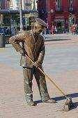 picture of sweeper  - Bronze Street sweeper monument in a street of Madrid